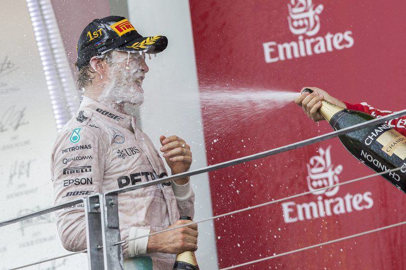 Azerbaijan Formula One Grand Prix • epa05377379 Winner German Formula One driver Nico Rosberg of Mercedes AMG GP (L) celebrates on the podium after the 2016 Formula One Grand Prix of Europe at the Baku city circuit, in Baku, Azerbaijan 19 June 2016.  EPA/VALDRIN XHEMAJ • Lusa