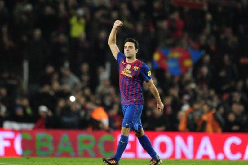 Xavi Hernandez • SPAIN, Barcelona : Barcelona's midfielder Xavi Hernandez celebrates after the second leg of the Spanish Cup quarter-final