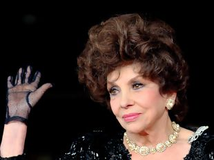 ITALY, Rome : Italian actress Gina Lollobrigida arrives for the premiere of the documentary film