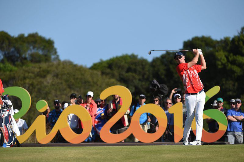 Olympic Games 2016 Golf • epa05481192 Justin Rose of Great Britain tees from the sixteenth hole during the third round of the Rio 2016 Olympic Games men's golf tournament at the Olympic Golf Course in Barra da Tijuca, Rio de Janeiro, Brazil, 13 August 2016.  EPA/FACUNDO ARRIZABALAGA • Lusa