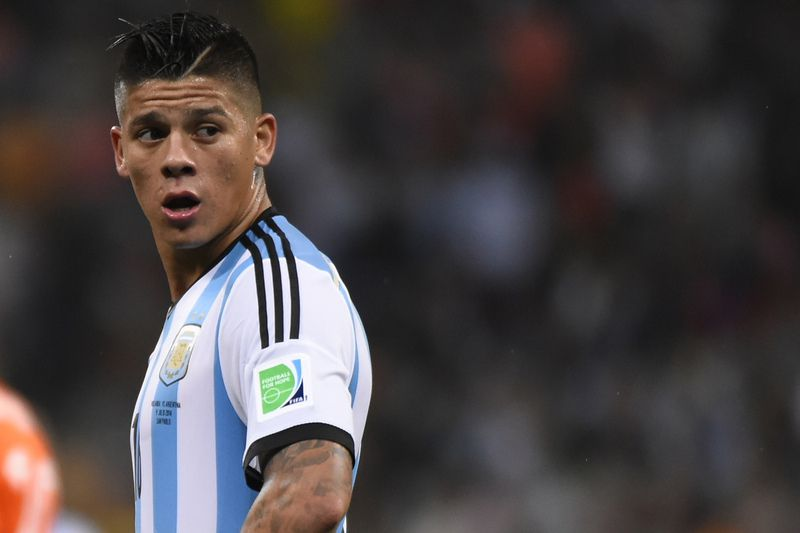 Rojo já fala como reforço do United • O lateral argentino assinou por cinco épocas • FABRICE COFFRINI / AFP