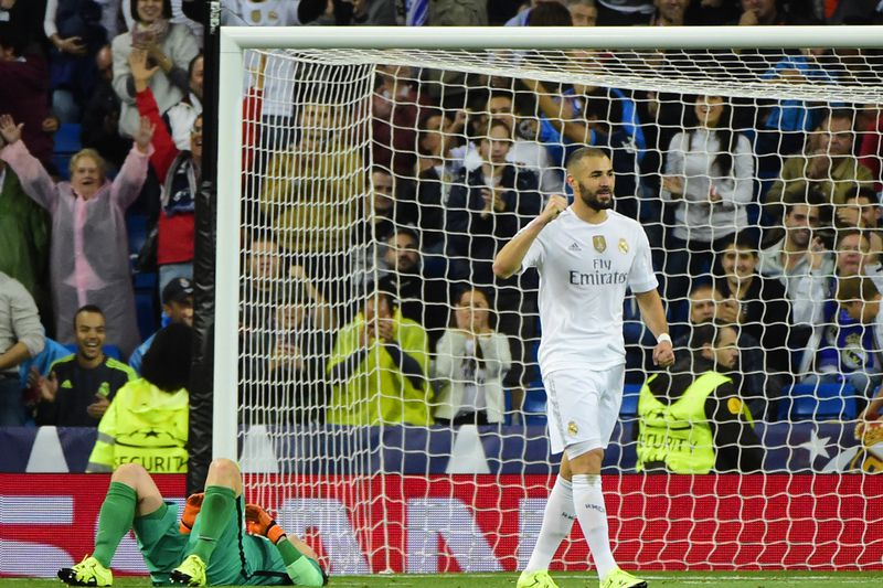 benzema • Real Madrid's French forward Karim Benzema celebrates after scoring a goal during the UEFA Champions League group A football match Real Madrid CF vs FC Shakhtar Donetsk at the Santiago Bernabeu stadium in Madrid on September 15, 2015. AFP PHOTO/ PIERRE-PHILIPPE MARCOU • AFP