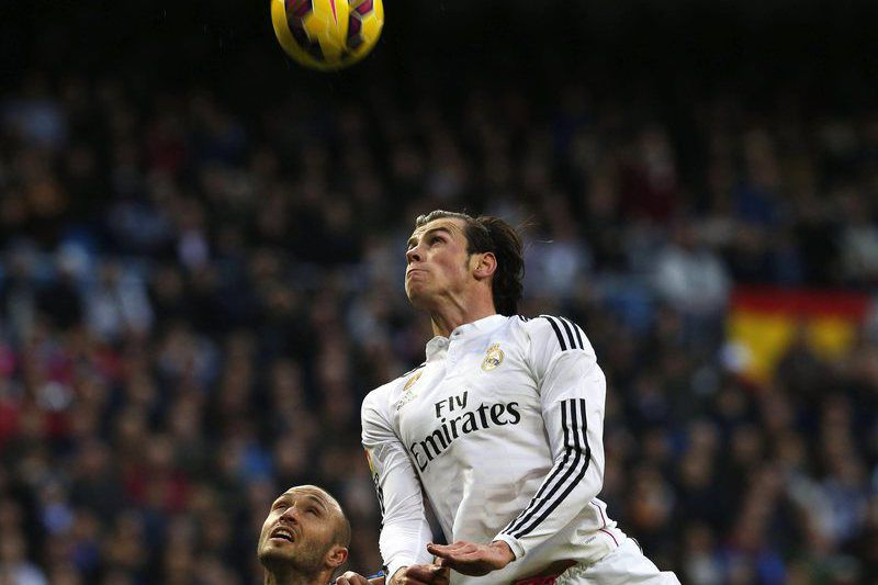 Real Madrid vs Deportivo La Coruna • epa04619709 Real Madrid's Welsh winger Gareth Bale (R) in action against Deportivo La Coruna's defender Laureano Sanabria (L) during the Spanish Primera Division soccer match between Real Madrid and Deportivo La Coruna at Santiago Bernabeu stadium in Madrid, central Spain, 14 February 2015.  EPA/KIKO HUESCA