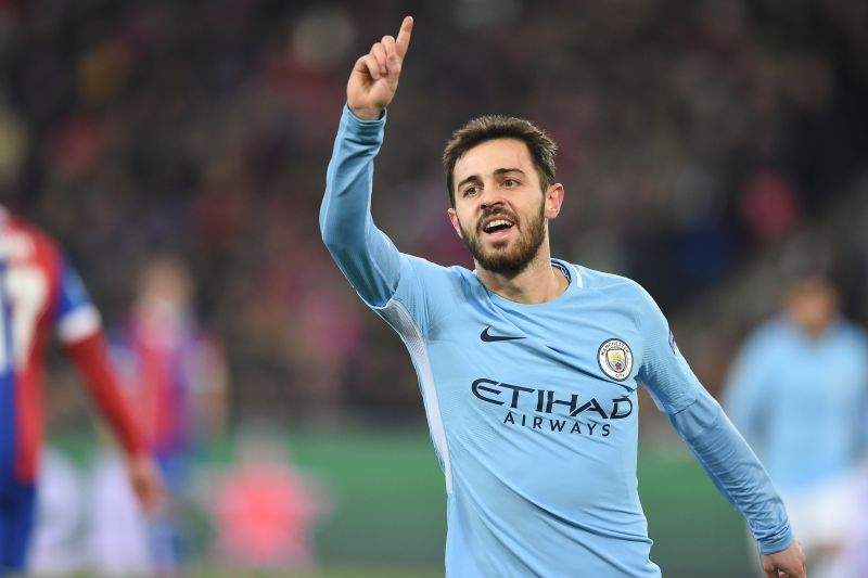 Manchester City's Portuguese midfielder Bernardo Silva celebrates after scoring a goal during the UEFA Champions League round of 16 first leg football match between Basel and Manchester City at the Saint Jakob-Park Stadium in Basel on February 13, 2018. / AFP PHOTO / SEBASTIEN BOZON