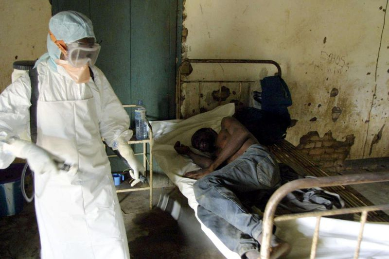 KEL01 - 20030309 - KELLE, CONGO : An agent of the Congolese Red Cross disinfects a room of the Kelle hospital, northwestern Congo, where an Ebola fever infected patient lies 09 March 2003. There is no known medical cure for Ebola, which is frequently transmitted by gorillas and other species, can kill in three days and is currently endangering villagers in northwest Congo, where 88 people have died. EPA PHOTO AFPI/DESIREY MINKOH