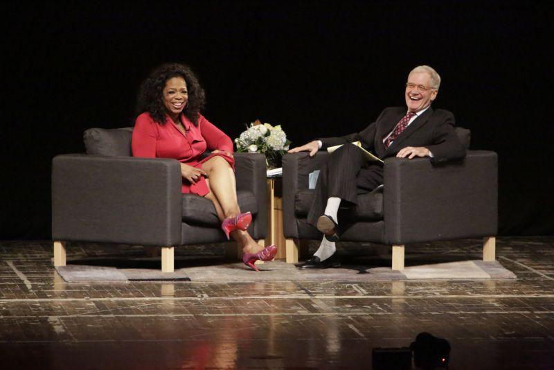 MUNCIE, IN - NOVEMBER 26: David Letterman (R) and Oprah Winfrey attend