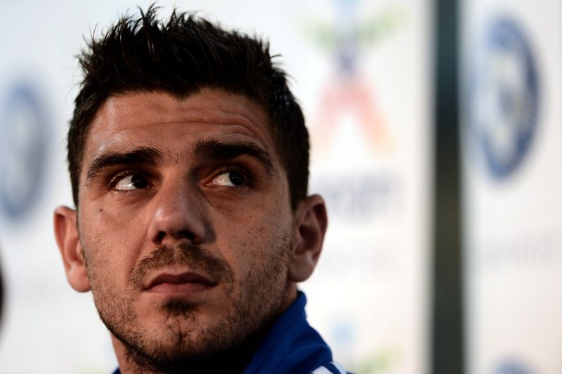 Greece's midfielder Konstantinos Katsouranis attends a press conference at the Municipal stadium of Legionowo on June 20, 2012. Greece will face Germany at the quarter-finals of the Euro 2012 football championships.    AFP PHOTO/ ARIS MESSINIS