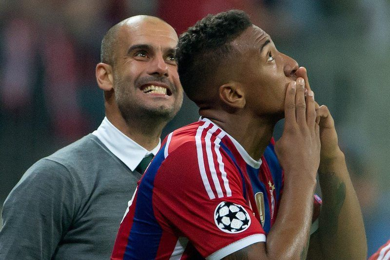 FC Bayern Munich vs Manchester City • epa04404858 Jerome Boateng (R) of FC Bayern Munich celebrates with head coach Pep Guardiola after scoring the winning goal during the UEFA Champions League group stage match FC Bayern Munich vs Manchester City in Munich Germany, 17 September 2014.  EPA/SVEN HOPPE