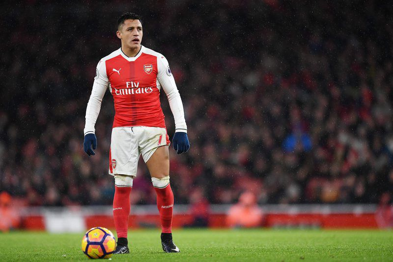 Alexis Sanchez • epa05694570 Arsenal's Alexis Sanchez prepares to take a free-kick during his teams match against Crystal Palace during an English Premier League soccer match at the Emirates Stadium in London, Britain, 01 January 2017.  EPA/ANDY RAIN   EDITORIAL USE ONLY. No use with unauthorized audio, video, data, fixture lists, club/league logos or 'live' service. Online in-match use limited to 75 images, no video emulation. No use in betting, games or single club/league/player publications
