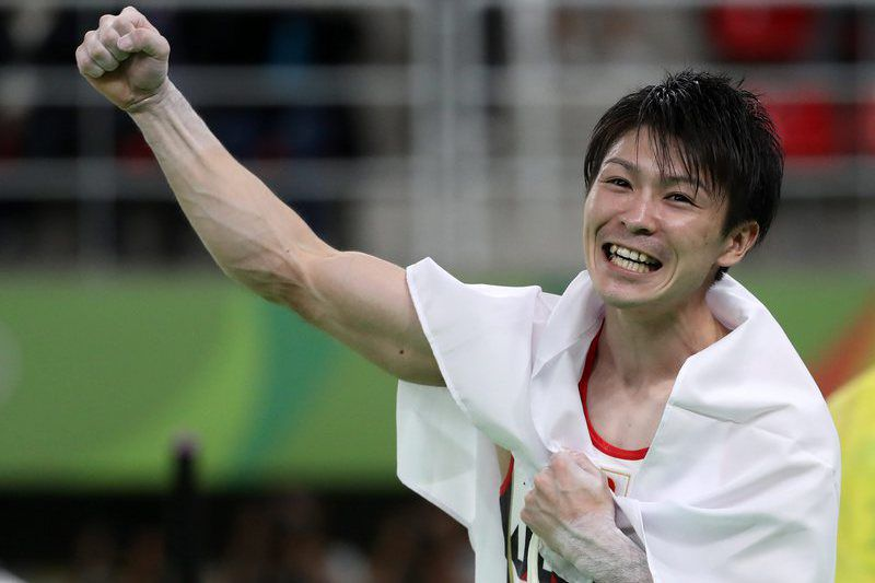 Olympic Games 2016 Artistic Gymnastics • epa05472120 Kohei Uchimura of Japan celebrates winning the men's Individual All-Around final of the Rio 2016 Olympic Games Artistic Gymnastics events at the Rio Olympic Arena in Barra da Tijuca, Rio de Janeiro, Brazil, 10 August 2016.  EPA/HOW HWEE YOUNG • Lusa
