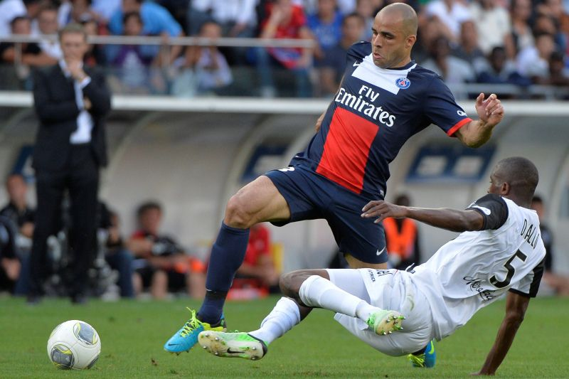 Paris Saint-Germain's Brazilian defender Alex Costa (Top) vies with Guingamp's Senegalese midfileder Mustapha Diallo during the French L1 football match between Paris Saint-Germain (PSG) and Guingamp at the Parc des Princes stadium in Paris, on August 31, 2013.  AFP PHOTO / KENZO TRIBOUILLARD