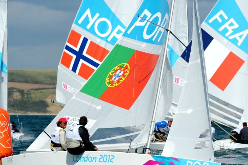 Portugese sailors Afonso Domingos and Frederico Melo round the mark with other crews in the Star sailing class practice race for the London 2012 Olympic Games, in Weymouth on July 28, 2012.  AFP PHOTO/William WEST • AFP ImageForum; WILLIAM WEST