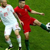 epa06811067 David Silva of Spain (L) and Raphael Guerreiro of Portugal in action during the FIFA World Cup 2018 group B preliminary round soccer match between Portugal and Spain in Sochi, Russia, 15 June 2018.  (RESTRICTIONS APPLY: Editorial Use Only, not used in association with any commercial entity - Images must not be used in any form of alert service or push service of any kind including via mobile alert services, downloads to mobile devices or MMS messaging - Images must appear as still images and must not emulate match action video footage - No alteration is made to, and no text or image is superimposed over, any published image which: (a) intentionally obscures or removes a sponsor identification image; or (b) adds or overlays the commercial identification of any third party which is not officially associated with the FIFA World Cup)  EPA/MOHAMED MESSARA   EDITORIAL USE ONLY  EDITORIAL USE ONLY