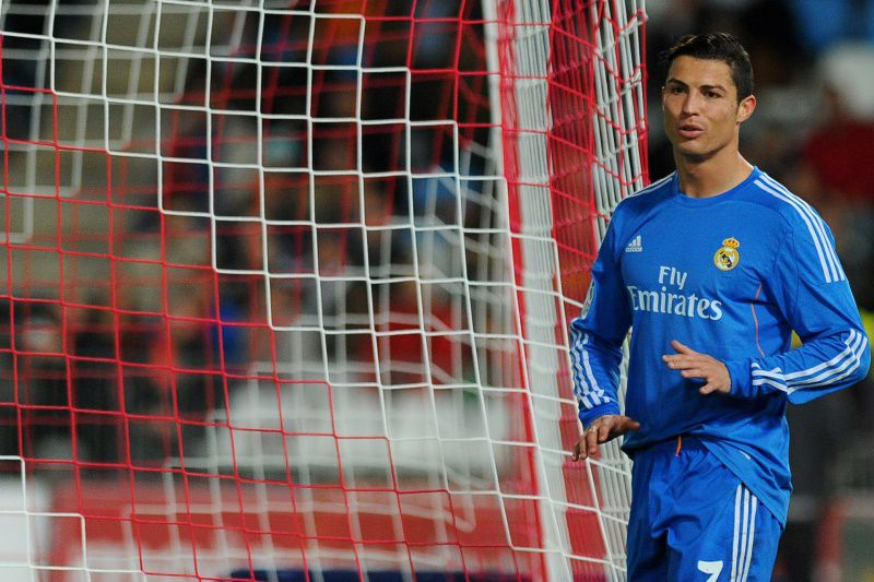 Real Madrid's Portuguese forward Cristiano Ronaldo reacts during the Spanish league football match UD Almeria vs Real Madrid CF at the Mediterraneo stadium in Almeria on November 23, 2013.  AFP PHOTO / JORGE GUERRERO