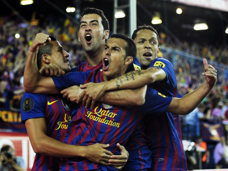 Barcelona's forward Pedro Rodriguez (C) celebrates with his teammates after scoring his team's first goal during the Spanish King's Cup final football match between Athletic Bilbao and Barcelona at the Vicente Calderon stadium in Madrid on May 25, 2012.    AFP PHOTO/JAVIER SORIANO