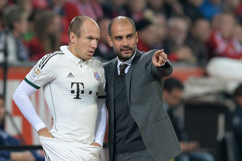 Robben com Guardiola • AFP@CHRISTOF STACHE