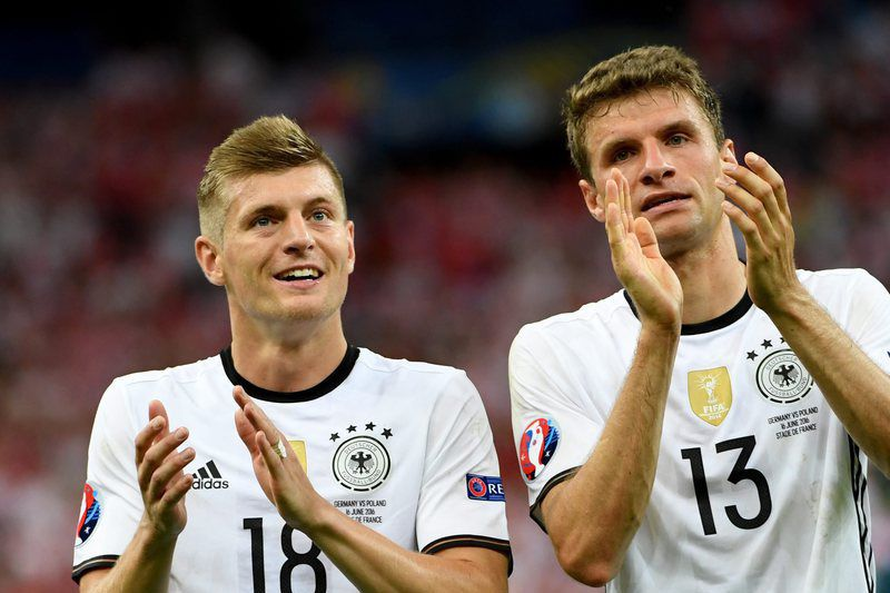 Group C Germany vs Poland • epa05371006 Toni Kroos (L) and Thomas Mueller of Germany react after the UEFA EURO 2016 group C preliminary round match between Germany and Poland at Stade de France in Saint-Denis, France, 16 June 2016.  (RESTRICTIONS APPLY: For editorial news reporting purposes only. Not used for commercial or marketing purposes without prior written approval of UEFA. Images must appear as still images and must not emulate match action video footage. Photographs published in online publications (whether via the Internet or otherwise) shall have an interval of at least 20 seconds between the posting.)  EPA/FILIP SINGER   EDITORIAL USE ONLY • Lusa