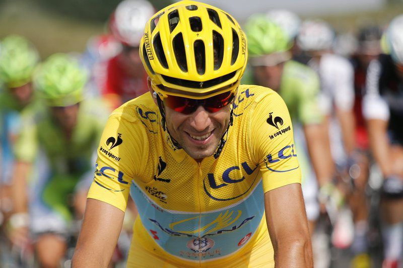 Tour de France 2014 21th stage • epa04332854 Astana Procycling team rider Vincenzo Nibali of Italy, wearing the leader's yellow jersey, in action during the 21st and final stage of the 101st Tour de France 2014 cycling race, over 137,5 km from Evry to Paris, by the Champs-Elysees, in France, 27 July 2014.  EPA/KIM LUDBROOK • epa04332854