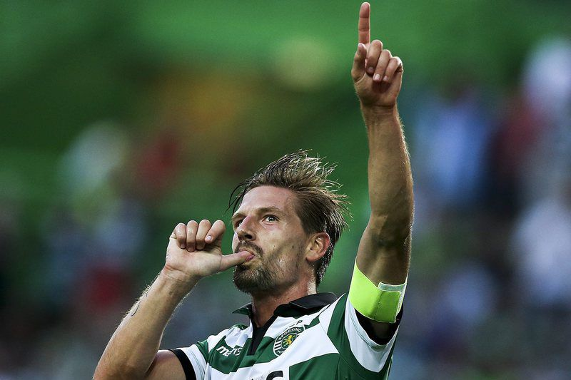 Sporting CP vs Wolfsburg • epa05449237 Sporting CP's Adrien Silva celebrates after scoring a goal against Wolfsburg during the 'Five Violins' trophy match Sporting CP vs Wolfsburg at Alvalade Stadium Lisbon Portugal 30 July 2015.  EPA/JOSE SENA GOULAO • Lusa