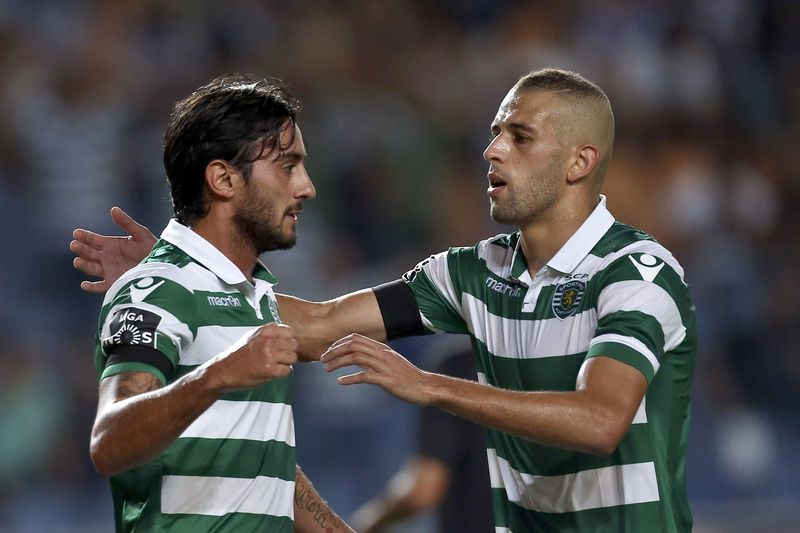 Academica vs Sporting Lisbon • Sporting Lisbon´s Aquilani (L) celebrates with team mate Slimani the scoring of a goal against Academica during their Portuguese First League soccer match held at Cidade de Coimbra Stadium, Coimbra, Portugal, 30th August 2015. PAULO NOVAIS/LUSA • Lusa