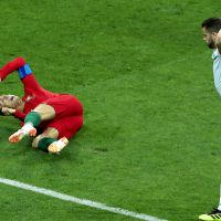 epa06811026 Cristiano Ronaldo of Portugal (down) reacts after being fouled by Nacho of Spain (R) during the FIFA World Cup 2018 group B preliminary round soccer match between Portugal and Spain in Sochi, Russia, 15 June 2018.  (RESTRICTIONS APPLY: Editorial Use Only, not used in association with any commercial entity - Images must not be used in any form of alert service or push service of any kind including via mobile alert services, downloads to mobile devices or MMS messaging - Images must appear as still images and must not emulate match action video footage - No alteration is made to, and no text or image is superimposed over, any published image which: (a) intentionally obscures or removes a sponsor identification image; or (b) adds or overlays the commercial identification of any third party which is not officially associated with the FIFA World Cup)  EPA/MOHAMED MESSARA   EDITORIAL USE ONLY  EDITORIAL USE ONLY