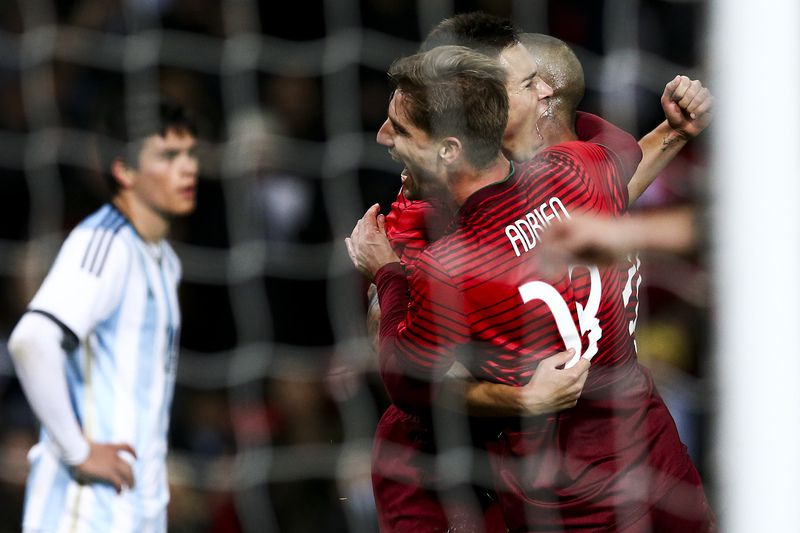 Argentina vs Portugal • Portugal players Adrien Silva (L), Ricardo Quaresma (R) and Raphael Guerreiro celebrate a goal against Argentina during their friendly match at Old Trafford Stadium in Manchester, England, 18 November 2014. JOSE SENA GOULAO/LUSA • LUSA