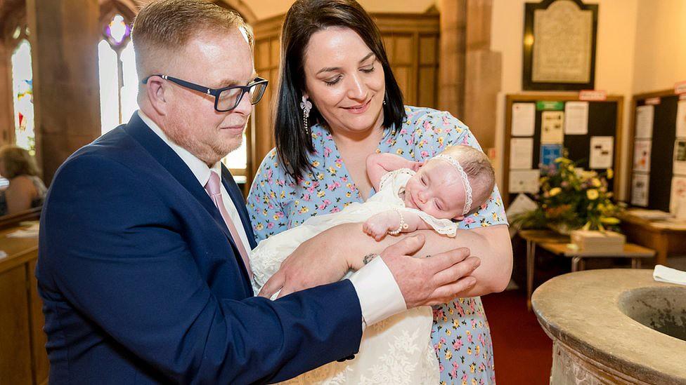 Laura e Dave no batizado de Ivy