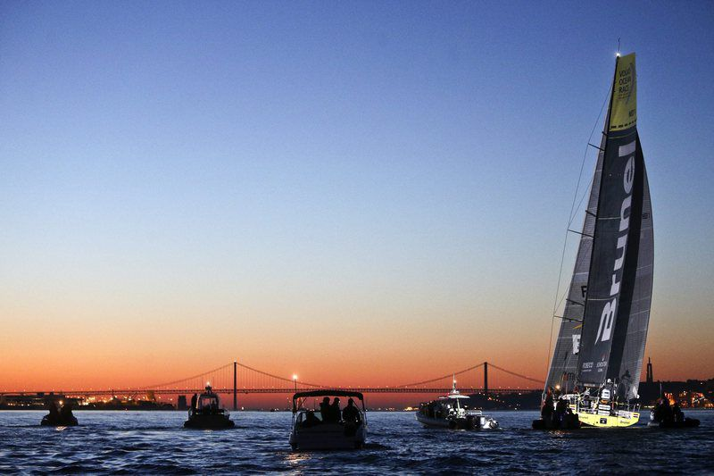 Volvo Ocean Race • epaselect epa04769573 Team Brunel skippered by Bouwe Bekking from The Netherlands arrives in first place in Lisbon, leaving 25th of April Bridge behind, at the end of leg seven of the Volvo Ocean Race, in Lisbon, Portugal, 27 May 2015. The Volvo Ocean Race is the world's premier ocean yacht race for professional racing crews with seven Volvo Ocean 65's, the worlds most technologically advanced open ocean racing yachts competing to be the quickest around the world.  EPA/MIGUEL A. LOPES