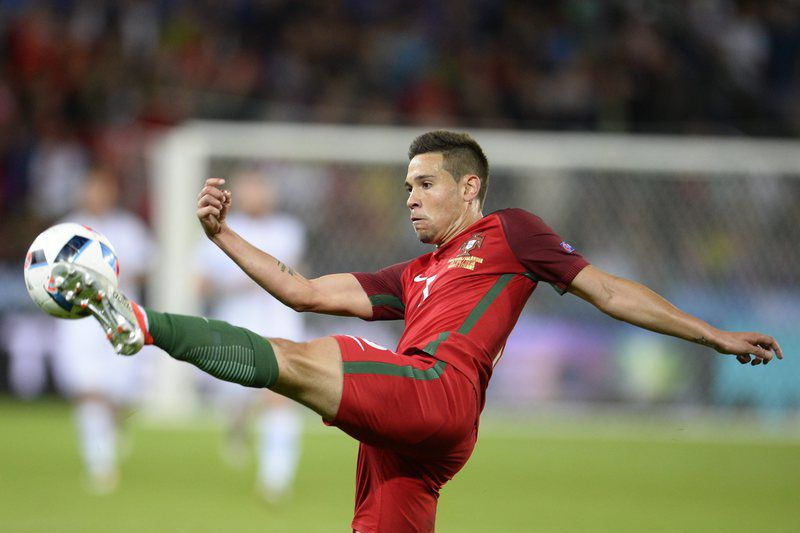 df31b187c93cc8789f0a31578b45817dd4891996.jpg • epa05365491 Raphael Guerreiro of Portugal in action during the UEFA EURO 2016 group F preliminary round match between Portugal and Iceland at Stade Geoffroy Guichard in Saint-Etienne, France, 14 June 2016.  (RESTRICTIONS APPLY: For editorial news reporting purposes only. Not used for commercial or marketing purposes without prior written approval of UEFA. Images must appear as still images and must not emulate match action video footage. Photographs published in online publications (whether via the Internet or otherwise) shall have an interval of at least 20 seconds between the posting.)  EPA/CJ GUNTHER   EDITORIAL USE ONLY • epa05365491