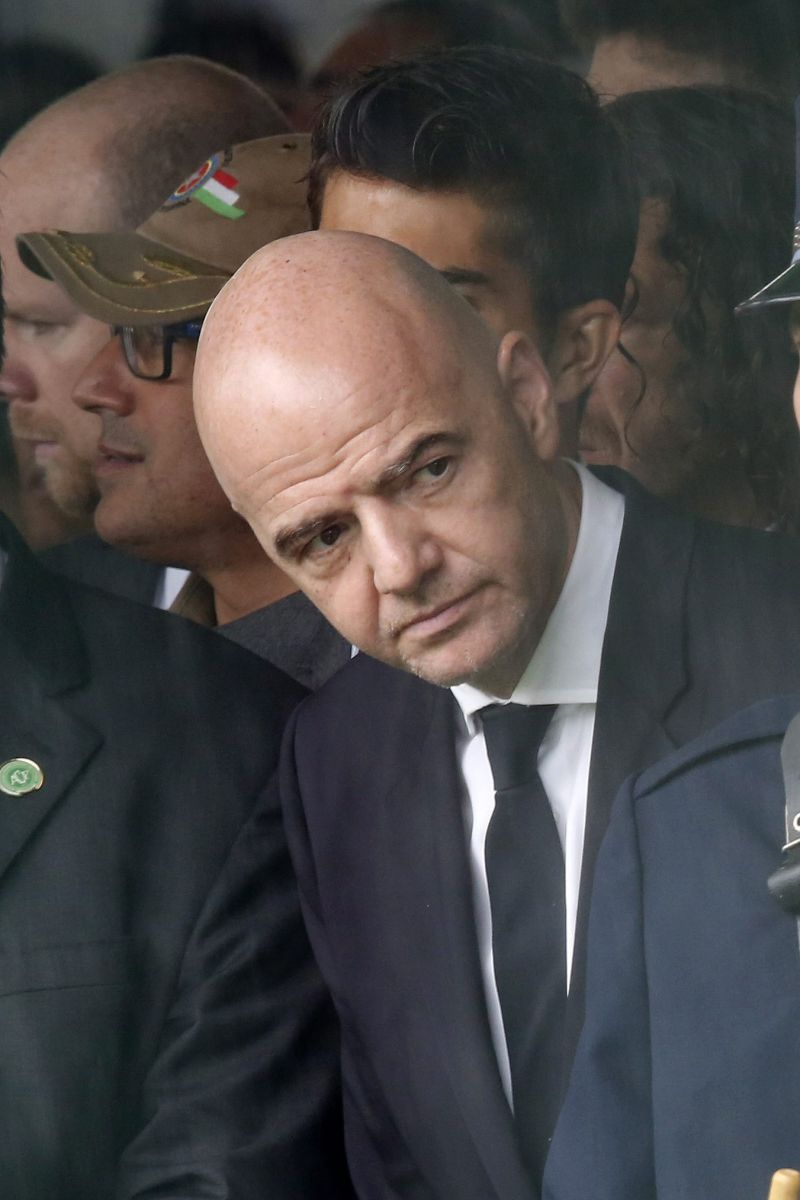 epa05658312 FIFA President Gianni Infantino attends the mass funeral ceremony for the 50 Brazilian victims of the 29 November plane crash in Colombia, at the Arena Conda stadium, in Chapeco, Santa Catarina, Brazil, 03 December 2016. The Brazilian victims of the plane crash included 19 Chapecoense players, 25 executives, coaches and special guests of the club and a score of journalists. 71 people died when an aircraft crashed late 28 November 2016 with 77 people on board in a mountainous area outside Medellin, Colombia. Brazilian soccer club Chapecoense were scheduled to play in the Copa Sudamericana final against Medellin's Atletico Nacional on 30 November 2016.  EPA/SEBASTIAO MOREIRA