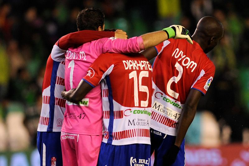 Granada's player celebrate during the Spanish league football match Real Betis vs Granada CF at the Benito Villamarin stadium in Sevilla on November 9, 2012.Granada won 1-2.AFP PHOTO/ CRISTINA QUICLER
