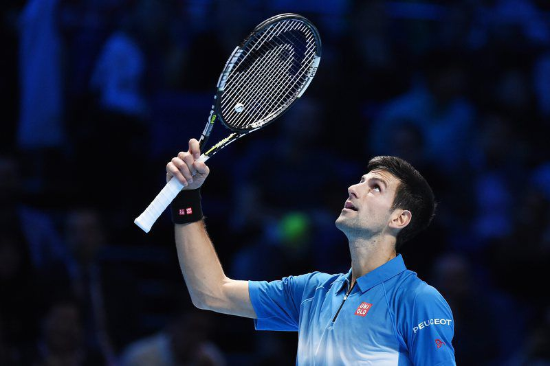 ATP Tour tennis finals in London • epa05033305 Serbia's Novak Djokovic reacts while playing Tomas Berdych of the Czech Republic during the ATP Tour tennis finals tournament at the O2 Arena in London, Britain, 19 November 2015.  EPA/ANDY RAIN • Lusa