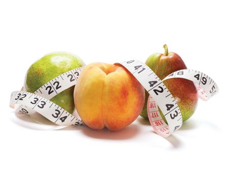 Tape Measure and Fruits on White Background
