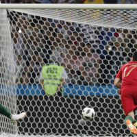 epa06811035 Cristiano Ronaldo (L) of Portugal score the 1-0 goal from the penalty spot during the FIFA World Cup 2018 group B preliminary round soccer match between Portugal and Spain in Sochi, Russia, 15 June 2018.  (RESTRICTIONS APPLY: Editorial Use Only, not used in association with any commercial entity - Images must not be used in any form of alert service or push service of any kind including via mobile alert services, downloads to mobile devices or MMS messaging - Images must appear as still images and must not emulate match action video footage - No alteration is made to, and no text or image is superimposed over, any published image which: (a) intentionally obscures or removes a sponsor identification image; or (b) adds or overlays the commercial identification of any third party which is not officially associated with the FIFA World Cup)  EPA/RONALD WITTEK   EDITORIAL USE ONLY