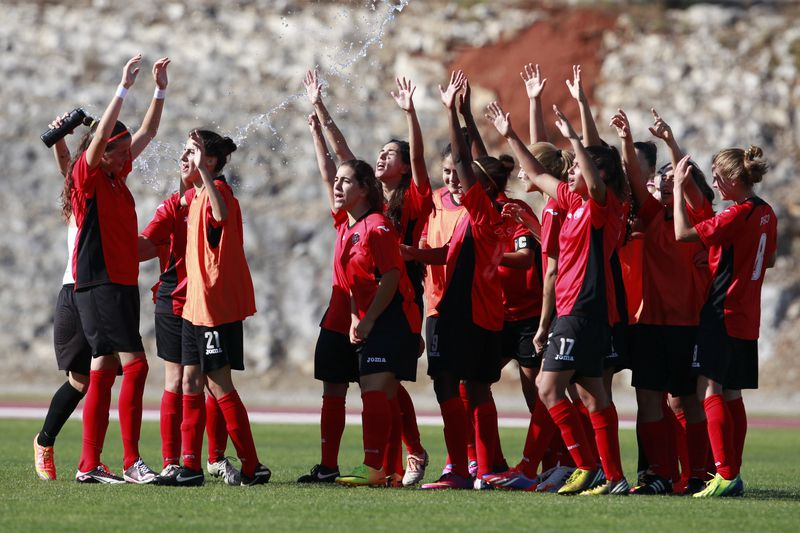 Clube Atletico Ouriense vs ASA Tel-Aviv University SC • Clube Atletico Ouriense players celebrate the victory against ASA Tel-Aviv University SC in the end of their UEFA Women's Champions League qualifying round soccer match, held in Fátima Stadium, 11 August 2014. • PAULO CUNHA/LUSA