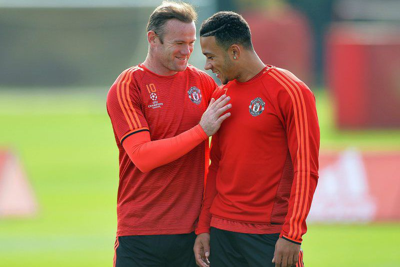 Rooney e Depay • PETER POWELL / EPA