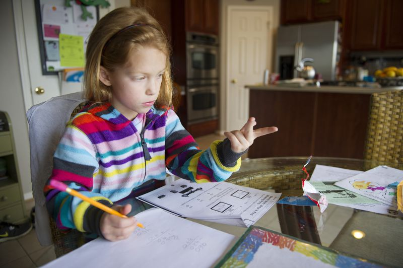 Autumn Watson does her homework in her dining room in Centreville, Maryland, after class at Centreville Elementary on April 30, 2013.   AFP PHOTO/JIM  WATSON