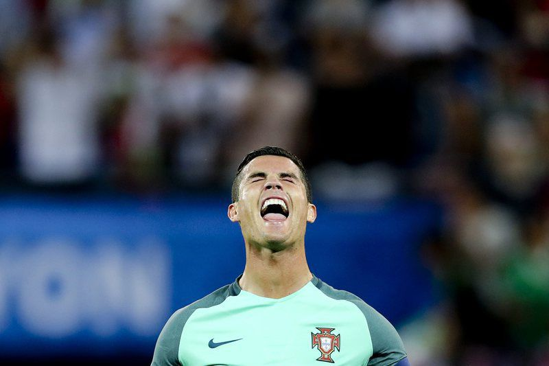 Semi final Portugal vs Wales • epa05411979 Portugal's Cristiano Ronaldo celebrates at the end of the UEFA EURO 2016 semi final match between Portugal and Wales at Stade de Lyon in Lyon, France, 06 July 2016. Portugal won 2-0.   (RESTRICTIONS APPLY: For editorial news reporting purposes only. Not used for commercial or marketing purposes without prior written approval of UEFA. Images must appear as still images and must not emulate match action video footage. Photographs published in online publications (whether via the Internet or otherwise) shall have an interval of at least 20 seconds between the posting.)  EPA/MIGUEL A. LOPES   EDITORIAL USE ONLY • Lusa