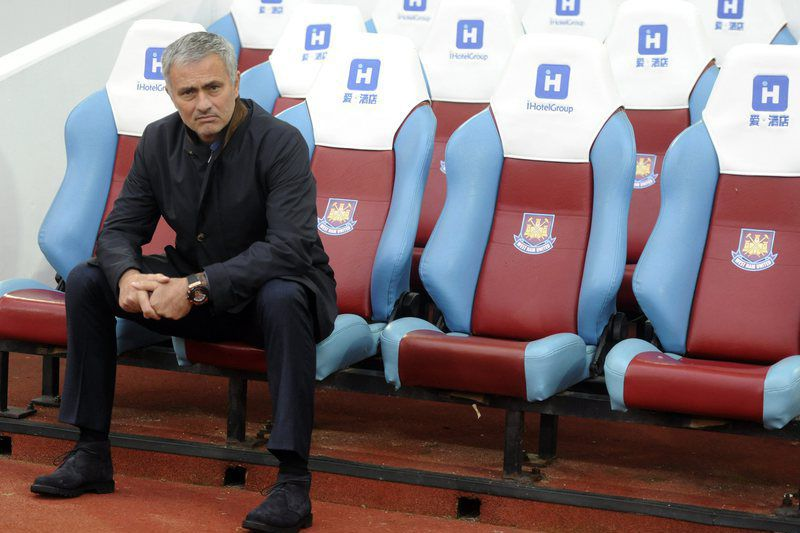 West Ham United vs Chelsea • epa04993523 Chelsea's Manager Jose Mourinho sits on his own before the start of the English Premier League soccer match between West Ham United and Chelsea at The Boleyn Ground in London, Britain, 24 October 2015.  EPA/HANNAH MCKAY EDITORIAL USE ONLY. No use with unauthorized audio, video, data, fixture lists, club/league logos or 'live' services. Online in-match use limited to 75 images, no video emulation. No use in betting, games or single club/league/player publications • Lusa