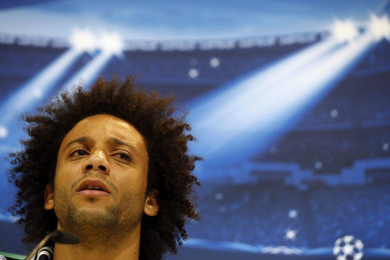 Real Madrid press conference • epa04474569 Real Madrid's Brazilian defender Marcelo attends a press conference in Madrid, Spain, 03 November 2014. Real Madrid will face Liverpool FC in the UEFA Champions League group B soccer match at the Santiago Bernabeu Stadium in Madrid on 04 November 2014.  EPA/JUAN CARLOS HIDALGO