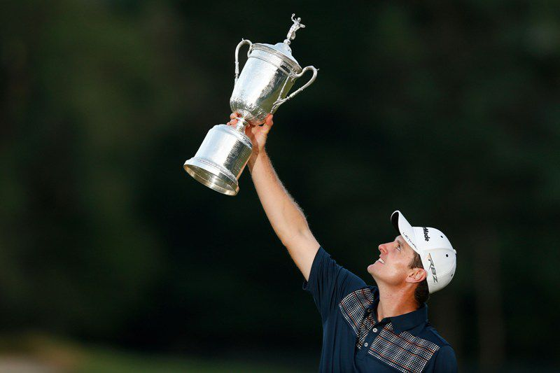 ARDMORE, PA - JUNE 16: Justin Rose of England celebrates with the U.S. Open trophy after winning the 113th U.S. Open at Merion Golf Club on June 16, 2013 in Ardmore, Pennsylvania.   Scott Halleran/Getty Images/AFP • AFP ImageForum; SCOTT HALLERAN