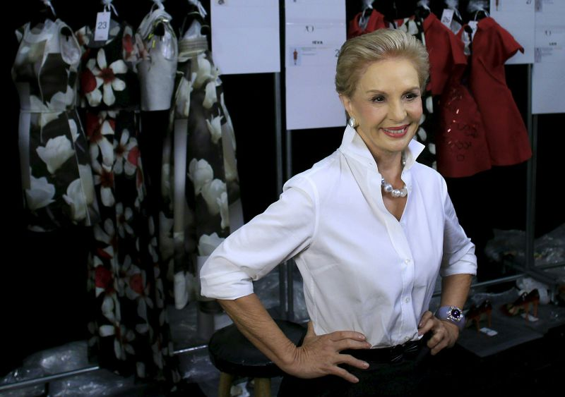 This file photo taken on September 08, 2014 shows fashion designer Carolina Herrera, standing backstage before previewing her Spring/Summer 2015 collection during New York Fashion Week. It was announced February 9, 2018 that Carolina Herrera, queen of elegance and favorite of US first ladies, is stepping down as chief designer of her eponymous label. The Venezuelan-born 79-year-old said she had appointed US designer Wes Gordon to take over as creative director after she takes the bow at her fall/winter 2018 fashion show at the Museum of Modern Art in Manhattan.