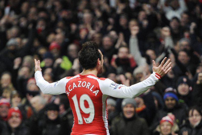 Santi Cazorla celebra o golo marcado • Santi Cazorla celebrates after scoring a goal against Newcastle during their English Premier League soccer match between Arsenal and Newcastle United at The Emirates Stadium in London, Britain, 13 December 2014. • EPA/FACUNDO ARRIZABALAGA