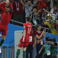 epa06811030 Cristiano Ronaldo (L) of Portugal celebrates after scoring the 1-0 goal during the FIFA World Cup 2018 group B preliminary round soccer match between Portugal and Spain in Sochi, Russia, 15 June 2018.  (RESTRICTIONS APPLY: Editorial Use Only, not used in association with any commercial entity - Images must not be used in any form of alert service or push service of any kind including via mobile alert services, downloads to mobile devices or MMS messaging - Images must appear as still images and must not emulate match action video footage - No alteration is made to, and no text or image is superimposed over, any published image which: (a) intentionally obscures or removes a sponsor identification image; or (b) adds or overlays the commercial identification of any third party which is not officially associated with the FIFA World Cup)  EPA/RONALD WITTEK   EDITORIAL USE ONLY
