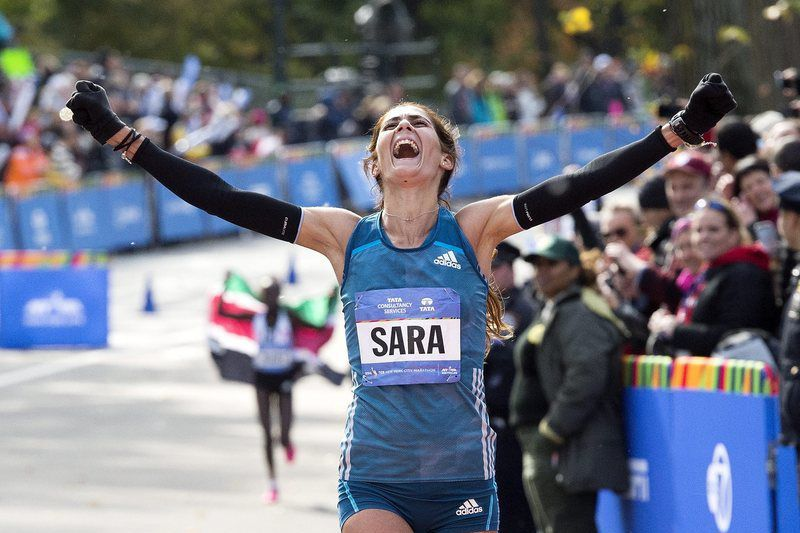 Sara Moreira • epa04473668 Sara Moreira, of Portugal, celebrates as she crosses the finish line in third place  of the 2014 New York City Marathon in New York, New York, USA, 02 November 2014.  EPA/JUSTIN LANE • EPA/JUSTIN LANE