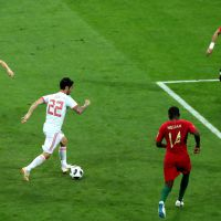 epa06811091 Isco of Spain (C) in action during the FIFA World Cup 2018 group B preliminary round soccer match between Portugal and Spain in Sochi, Russia, 15 June 2018.  (RESTRICTIONS APPLY: Editorial Use Only, not used in association with any commercial entity - Images must not be used in any form of alert service or push service of any kind including via mobile alert services, downloads to mobile devices or MMS messaging - Images must appear as still images and must not emulate match action video footage - No alteration is made to, and no text or image is superimposed over, any published image which: (a) intentionally obscures or removes a sponsor identification image; or (b) adds or overlays the commercial identification of any third party which is not officially associated with the FIFA World Cup)  EPA/MOHAMED MESSARA   EDITORIAL USE ONLY  EDITORIAL USE ONLY