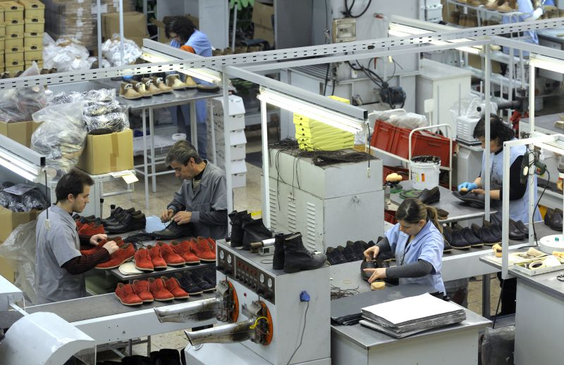 People work at a footwear factory of the Kyaia Group, near Guimaraes, northern Portugal, on January 13, 2012. The footwear industry in Portugal shows in 2011 a record growth with innovative products that have emerged internationally, as the country tries to revive its economy hit hard by the crisis.