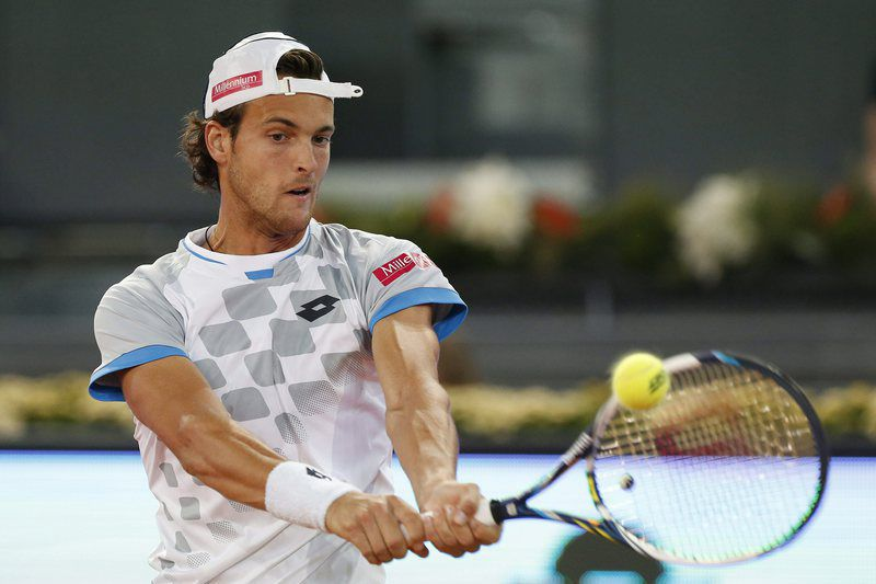 Madrid Mutua Open tennis tournament • epa04734703 Portuguese tennis player Joao Sousa in action against Swiss Stanislas Wawrinka duringtheir second round match for the Madrid Open tennis tournament at Caja Magica sports pavilion in Madrid, Spain, 05 May 2015.  EPA/ALBERTO MARTIN • Lusa