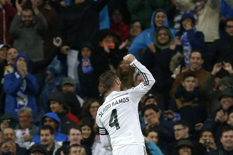 Real Madrid • epa04481856 Real Madrid's defender Sergio Ramos celebrates after scoring the 2-0 lead against Rayo Vallecano during the Spanish Liga Primera Division soccer match played at Santiago Bernabeu stadium in Madrid, Spain, 08 November 2014.  EPA/Javier Lizon