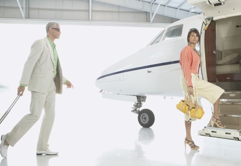 Couple boarding airplane in hanger, Nobato, California, United States